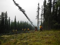 <p>A crew clears a firebreak on the Anaconda Fire in this undated photo provided by theNational Wildfire Coordinating Group.</p>