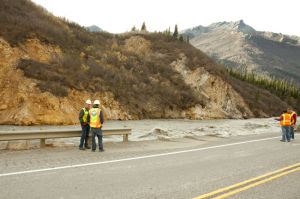 Raging Nenana River chews away at Parks Highway near Denali