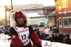 Therapy, husband lead musher back to Iditarod