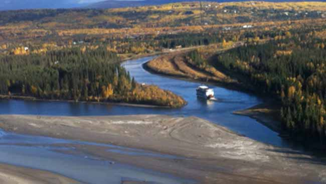 Chena River grows with the flow, as Tanana meanders south