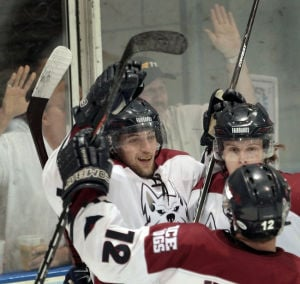 Ice Dogs rally to take Game 1