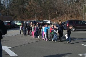 Man kills 26 at Conn. school, including 20 kids