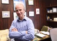 <p>Certified Public Accountant Andy Warwick poses in his office Tuesday afternoon, April 14, 2015. Warwick was named the UAF School of Management's 2015 Business Leader of the Year.</p>