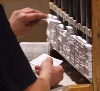 <p>Tim Ketzler sorts tickets for the 2015 Nenana Ice Classic Thursday afternoon, April 16, 2015 in the Nenana Community Center.</p>