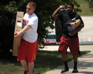 130723_chiefsarrive6: Chiefs rookie running back Knile Davis gets some help with a flat screen television Monday as Chiefs personnel start to report for training camp. - Todd Weddle | St. Joseph News-Press