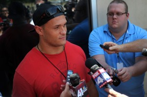 130723_chiefsarrive4: Mike Catapano speaks with the media as he and other rookies report in at the 2013 Chiefs Training Camp Monday on the Missouri Western State University campus. - Todd Weddle | St. Joseph News-Press
