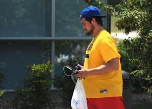 130723_chiefs_madison_tw: Rookie defensive lineman Brad Madison, a graduate of South Harrison High School and the University of Missouri, takes some of his belongings to Scanlon Hall Monday afternoon on Missouri Western's campus. Madison joined the Chiefs as an undrafted free agent in April. - Todd Weddle | St. Joseph News-Press