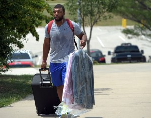 130723_chiefsarrive2: Chiefs rookie linebacker Nico Johnson brings some personal items into the dorms Monday as players start arriving for the 2013 Chiefs Training Camp on the Missouri Western State University campus - Todd Weddle | St. Joseph News-Press