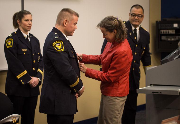 uc alumnus  cincinnati police officer promoted  eager to