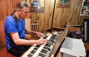 <p><strong>GRAND FUNK</strong> Railroad lead singer and former Norfolkan Max Carl plays the keyboard at a recent stop in his hometown. The performer recently moved back to Nebraska and is working on a documentary about the history of American music.</p>