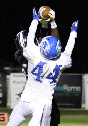 <p>Coosa's Eriq Dozier and Armuchee's Thomas Reese (44) go up for a pass form Coosa's Logan Pledger in the second quarter of a game Friday, Sept. 30, 2016, at Coosa. (Jeremy Stewart/RN-T.com)</p>