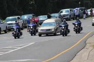 <p>FuneralHearse0365</p><p>The hearse carrying the body of Navy Petty Officer 2nd Class Randall Smith traveled through Fort Oglethorpe along Battlefield Parkway Tuesday afternoon, July 28, on its way to the Chattanooga National Cemetery. Smith was one of five servicemen killed during a mass Chattanooga, Tenn., shooting on Thursday, July 16. (Catoosa News photo/Adam Cook)</p>