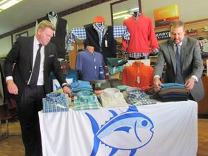 <p>Stephen Casey and Ron Casey check new arrivals in Holmes Clothing, a landmark business in Cedartown.</p>