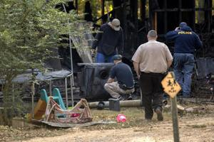 <p>Investigators work the scene near Trion, Ga., where multiple people were killed in an overnight fire that engulfed a single wide trailer home in Trion, Ga. State officials say the fire was caused by an improperly installed wood stove. (Dan Henry/The Chattanooga Times Free Press via AP)</p>