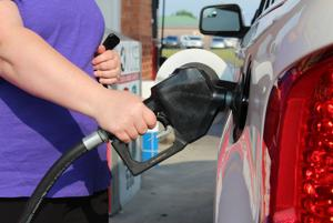 <p>A consumer fuels up her vehicle Tuesday, June 30, 2015,  at Kroger in Calhoun.</p>