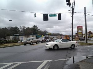 <p>Drivers stop for one another at the intersection of Main Street and Queen Street during a power outage in Polk County. </p>