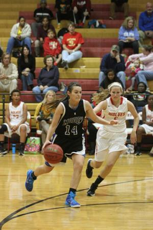 <p>Model's Rachel Mcfry (14) pushes down the court around Rome's Rebeckah Hufstetler (5) against the Lady Wolves at Rome on Tuesday, Nov. 25, 2014. (Sierra Campbell/Rome News-Tribune)</p>