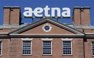 <p>FILE - In this Tuesday, Aug. 19, 2014, file photo, a sign for Aetna Inc., sits atop a building at the company headquarters in in Hartford, Conn. Health insurer Aetna Inc. has made a deal to buy competitor Humana Inc. in a $37 billion deal the companies say would create the second-largest managed care company, it was announced Friday, July 3, 2014. (AP Photo/Jessica Hill, File)</p>