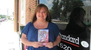 "<p>FILE - Local author Mary Duncan poses with her book, Young Love and Tragedy, outside the Cedartown Standard office in 2012. She has a new book out, ""Fatal Choices."" (Melody Dareing/thepolkfishwrap.com)</p>"
