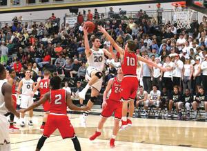 <p>Calhoun's Chapin Rierson (20) rises up for a shot between Sonoraville's Trent Daniel (2), Bryce Waters (24) and Wil Walraven (10) on Tuesday. (Larry Greeson, For the Calhoun Times)</p>