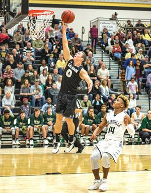<p>Calhoun's Rhett Abernathy (0) goes up for a lay-up in front of Adairsville's Mason Boswell during the first half on Friday. (Tim Godbee, For the Calhoun Times)</p>