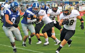 <p>Calhoun's Cole Jackson (right) looks for running room against Gordon Central defenders Tyler Bell (9) and Bayley Whittle (5). (Larry Greeson, For the Calhoun Times)</p>