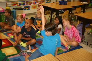 <p>Destiny Womack has a definite opinion about why Fudge is acting the way he does as her teacher Ann Marie Culbreth asks her class to discuss the plot of one of the Fudge books by Judy Blume. The second-grade class was listening to the story before they went to the library. Pictured from left, first row, are: Mary Burke Smith, Izzy Jennings, Brycen Harris and Destiny. From left, second row, are: Emily Richie, Torren Stamey, Catarina Domingo-Gaspar and Hayden O'Weger. For more photos from a busy Monday at East Central Elementary, see Wednesday's Young Romans.(Kristina Wilder / RN-T.com)</p>
