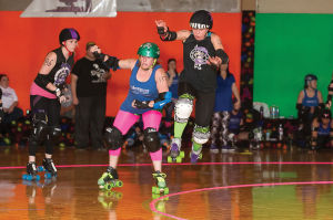 """<p>""""Amber Graves of Slain,"""" also known as Amber Catalano (left), and """"Gin N Jukes,"""" Jessie Hill (right), compete on the rink. Both are members of the Rome Rollergirls. (Photo by R. Steven Eckhoff)</p>"""