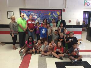 <p>Students in the Northside Elementary DawgBots robotics club received a donation from George Gibbons from Waste Industries of new Sphero robots the club will use later on the in year to compete. </p>