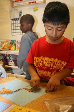 <p>Erick Chitop-Mejia, a first-grader at Elm Street Elementary School, made a giraffe using sticks and leaves. The assignment was to make an animal using leaves the students picked up recently. The animal had to be doing something because the class is studying verbs.(Kristina Wilder / RN-T.com)</p>