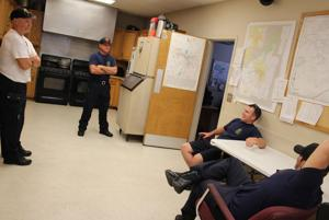 <p>Firefighters Steve Bailey (from left), Tim Causby, Landon Tibbitts and Chris Clayton talk in the kitchen at Station 1's fire hall, 617 W. First St. The kitchen hosts many discussions between firefighters, Bailey said. (Spencer Lahr / Rome News-Tribune)</p>