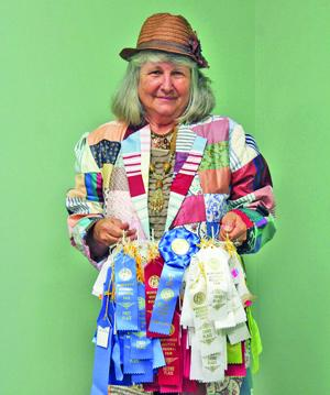 <p>Doris Blaylock displays the 120 ribbons she was awarded during this year's Northwest Georgia Regional Fair.</p>
