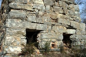 <p>The remains of the double-chamber cement furnace can be seen today about a mile and a half outside of Kingston on the east side of Hall Station Road.</p>