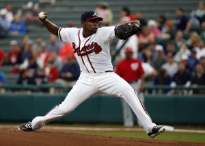 <p>Atlanta Braves starting pitcher Julio Teheran (49) throws in the first inning of a spring exhibition baseball game against the Washington Nationals, Thursday, March 6, 2014, in Kissimmee, Fla. (AP Photo/Alex Brandon)</p>