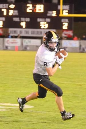 HIGH SCHOOL FOOTBALL: Warriors give fifth-ranked Jacksonville all they can handle in 22-7 setback