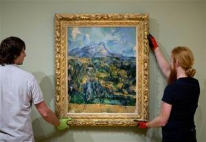 "<p>In this Oct. 14, 2014 photo, preparators Ed Hill, left, and Tommy Sapp hang Paul Cézanne's ""Mont Sainte-Victoire"" as part of the High Museum's new exhibit, ""Cezanne and the Modern: Masterpieces of European Art from the Pearlman Collection,"" in Atlanta. (AP Photo/David Goldman)</p>"