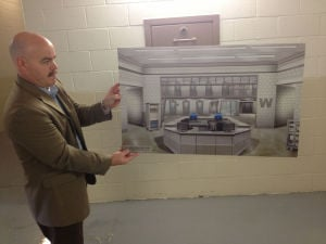 <p>Floyd County sheriff's chief deputy Tom Caldwell displays an artist's rendering of how a new medical pod at the jail would appear. Voters approved a $2.2 million renovation to the jail for more medical beds, not the larger project initially proposed. (Alan Riquelmy/RN-T.com)</p>