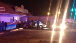 <p>Police convene at the scene of a shooting at Big H at 29 E. Main St. (Carolyn Grindrod / RN-T)</p>