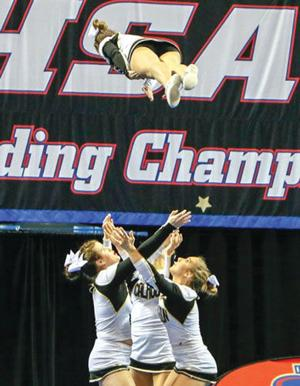 <p>Calhoun cheerleaders perform a stunt during their routine on Saturday at State in Columbus. (Doug Smith, Contributed Photo)</p>
