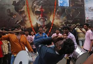 "<p><span id=""_oneup"" style=""font-size: 12px;"">Fans of Indian superstar Rajinikanth beat drums and dance outside a cinema hall to celebrate the screening of ""Kabali"" in Hyderabad, India, Friday, July 22, 2016. Private companies declared a holiday and parents kept children out of school as an air of celebration swept southern India for the premiere of Rajinikanth's latest film. Hundreds of thousands of Rajinikanth fans thronged cinemas across Tamil-language India and Malaysia to catch the pre-dawn showing of ""Kabali,"" a gangster movie that left patrons jumping from their seats and dancing in the aisles at the sight of their hero. (AP Photo/Mahesh Kumar A.)</span></p>"