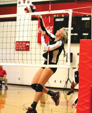 <p>Sonoraville's Haley Ponder spikes the ball over the net during her team's State second-round match against Central-Carrollton on Tuesday. (Larry Greeson, For the Calhoun Times)</p>