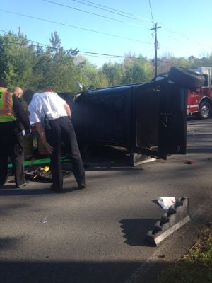 Vehicle flipped on Calhoun Road, driver extricated