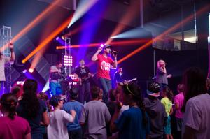 <p>Middle school students from Long Hollow Baptist Church in Hendersonville, Tenn., participate in worship service at Shorter University as part of the church's summer youth camp in Rome. (Photo contributed by Shorter University)</p>
