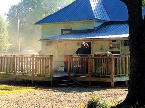 <p>Walker County Emergency Services, along with Walker State Prison firefighters and Chickamauga police, were dispatched to a residence, at Hood Avenue and Ninth Street in Chickamauga, where a fire started in the kitchen. The resident's dog perished in the blaze. (Messenger photo/Josh O'Bryant)</p>