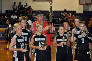 <p>The 11U Rome Gladiators won the 11-year-old AAU Southern Regional championship on Sunday, July 17, in Newnan. The team includes Bryson Thacker (from left), Braxton Wade, Jaxon Pate, coach Kelly Fountain, Ashton Williams, Braden Bell, Brady Groce and Reece Fountain. (Contributed photo)</p>