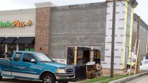 <p>The new home for a Sprint celllular service dealership is nearing completion on Turner McCall Blvd. near the Fifth Avenue intersection. (DOug Walker, RN-T)</p>