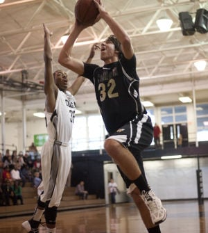 BOYS BASKETBALL: Jackets hold off Eagles for win