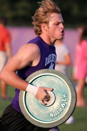 <p>Kelan Stepp carries a wieght as he runs back to the start of the plate relay event during Darlington's football team's Iron Tiger competition Thursday, July 21, 2016. (Jeremy Stewart/RN-T.com)</p>