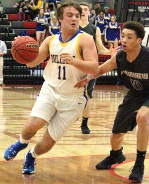 <p>Piedmont's Taylor Hayes, left, tries to drive past Plainview's Jeffrey Armstrong inside the paint during their Class 3A Northeast Regional semifinal game on Monday at Jacksonville State University. Photo by Shannon Fagan.</p>