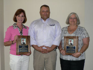 <p>Rome-Floyd E.C.O. River Eduction Center volunteers Gena Flanigen (left) and Lou Dana Lovelace (right) were presented The Touchstone Award by center Director Ben Winkelman (center) during the Rome City Commission meeting Monday, Aug. 25, 2014. The award is named in honor of long time wildlife biologist Ted Touchstone, who served the Northwest Georgia area and the state of Georgia. (Jeremy Stewart/RN-T.com)</p>